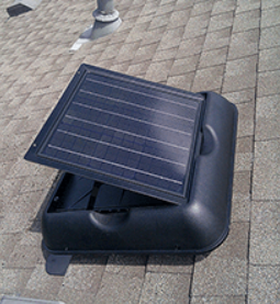 A Solar Attic Fan Opens Up to Release Heat Stored Up From Sunlight