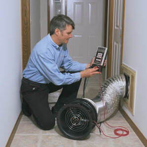 An HVAC Technician Tests a Duct Line for Leaks
