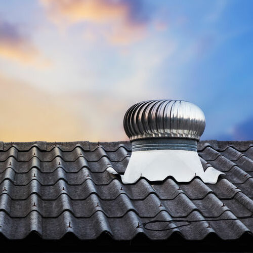 A Metal Roof and Vent in Front of a Lovely Sunset